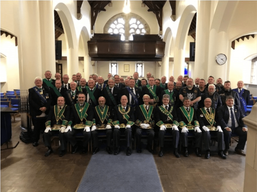 Assembled Brethren with the Chapel at the Queen Victoria School